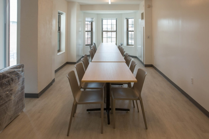 long table desk in middle of room in affinity housing