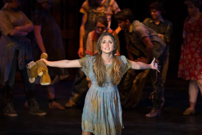 Little Sally laments the plight of Urinetown, the place.