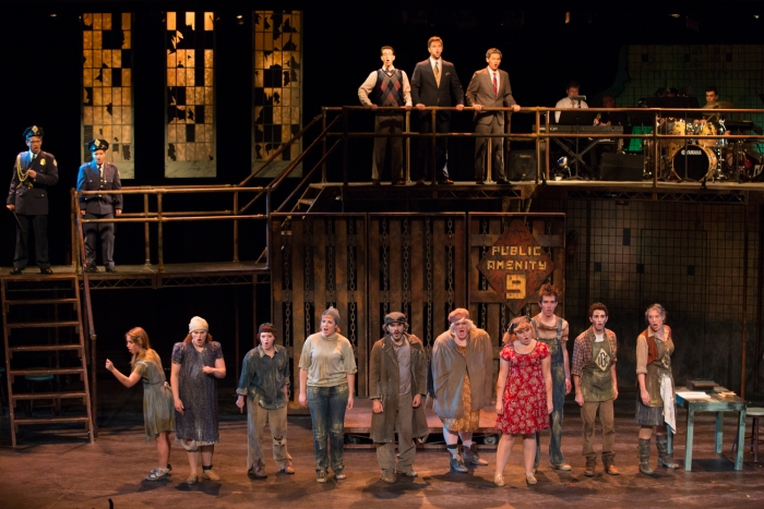 A contentious group in Urinetown.