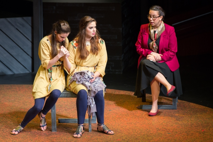 Dr. Head, played by Victoria Neiman-Vigo, talks with Diana as Ana holds her tightly.