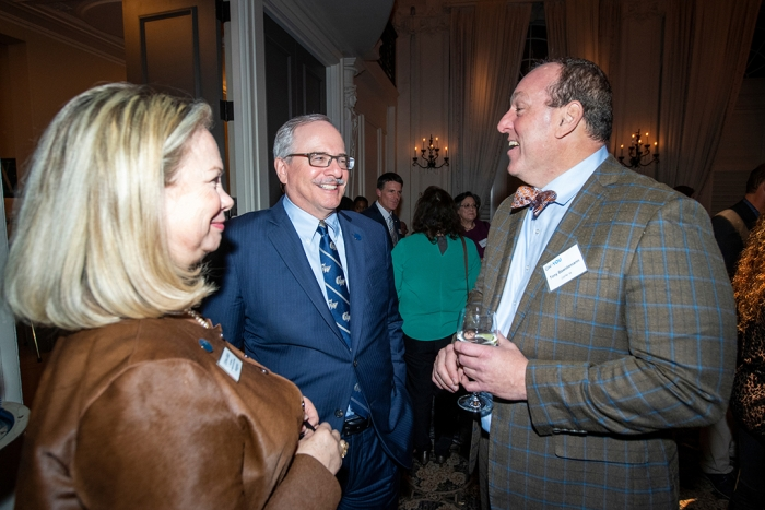 Donna Arbide and President LeBlanc talk with Tony Bawidamann, M.A. '96 during the cocktail hour at GW + You Philadelphia.