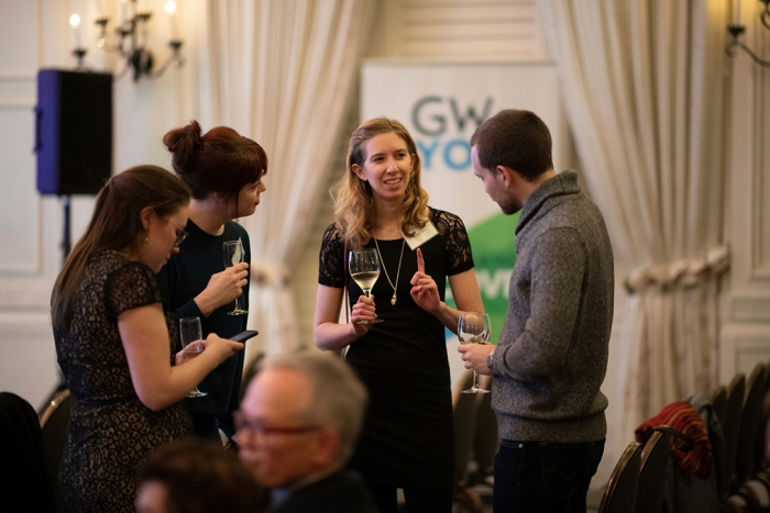 Alumni and guests mingle during cocktail hour at GW + You.