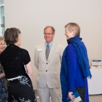 John Wetenhall, director of the museum, greets supporters.