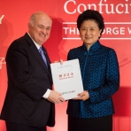 President Knapp and Vice Premier Liu show off a donated book. The Council of Confucius Institute Headquarters will donate more t