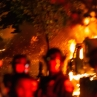 Image of helmeted figures among flames