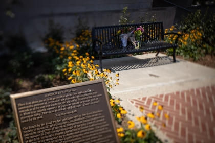 Flowers on GW's Toni Morrison bench commemorate the life of the monumental thinker and author. (Harrison Jones/GW Today)