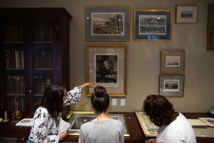 "Students from ""George Washington and His World"" class examine artifacts from the Small Washingtoniana collection."
