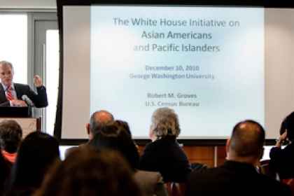 speaker at podium with screen behind him, White House Initiative on Asian Americans and Pacific Islanders, is apparent on screen