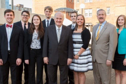 President Steven Knapp and Provost Steven Lerman with the university's distinguished scholars.