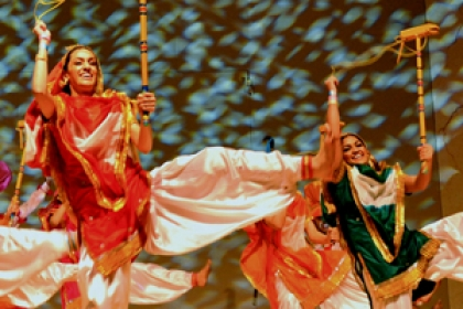 Bhangra Blowout dancers on stage in traditional costumes