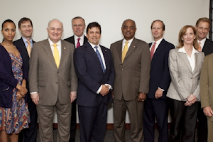 Board of Trustees members stand in a group