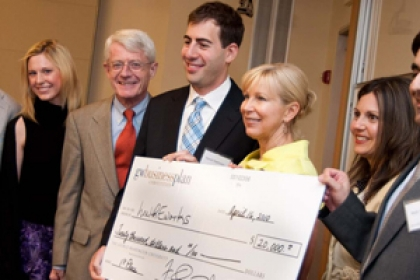 winners of business plan competition with oversized check smiling