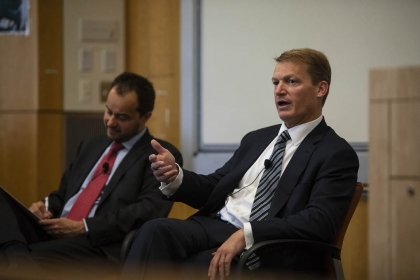 Director of CCHS Frank Cilluffo (left) and Kevin Mandia, A George Washington University alumnus and CEO of FireEye, discuss attr