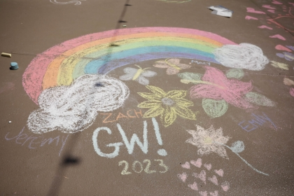 Chalk-in drawing of a rainbow.