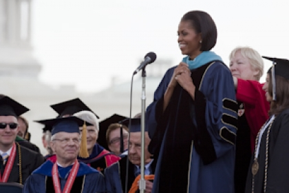 Michelle Obama receives honorary degree with the U.S. Capitol in the background and members of the university community looking
