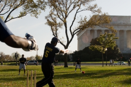 Cricket players on National Mall with Lincoln Memorial in background