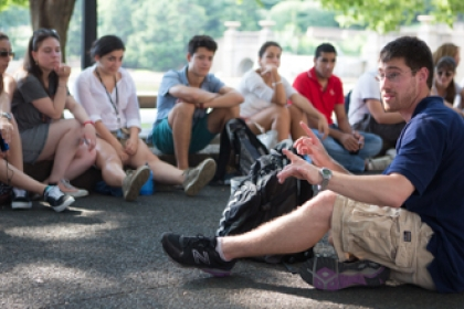 Cyprus Summer Youth Institute students and guides sit down while discussing history