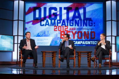 Digital campaign strategists Zac Moffat (left) and Michael Slaby (right) in a panel discussion with SMPA Director Frank Sesno.