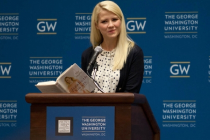 Elizabeth Smart reads from book standing in front of podium