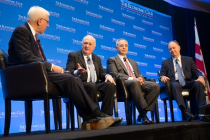 Steven Knapp speaks on stage with three other college presidents during panel discussion