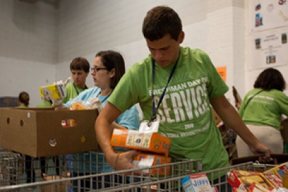 students volunteering in food bank on freshman day of service