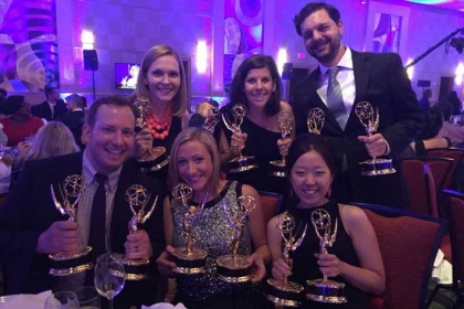 Marketing and Creative Services staff celebrates two regional Emmy wins.