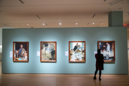 """A visitor to the GW University Museum and The Textile Museum views Norman Rockwell's """"Four Freedoms"""" paintings. (Harrison Jones/"""