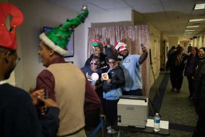 Employees rock a selfie station at the Foggy Bottom holiday party. (William Atkins/GW Today)