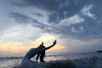 Image of person dancing in body of water