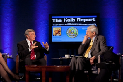 Kalb Report set with panelists sitting on stage on chairs