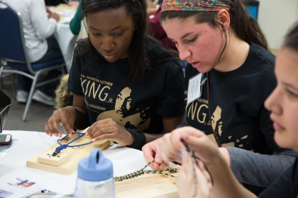 At Operation Survival, volunteers assembled paracord bracelets for active service military members.