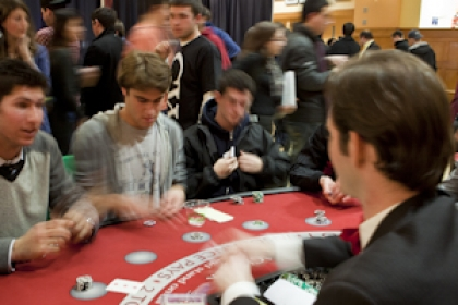 group of male students play blackjack seated at casino table at Martha's Marathon