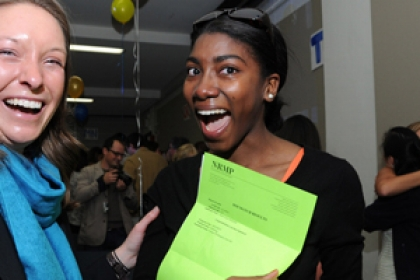 happy students celebrating at Match Day holding their match letters
