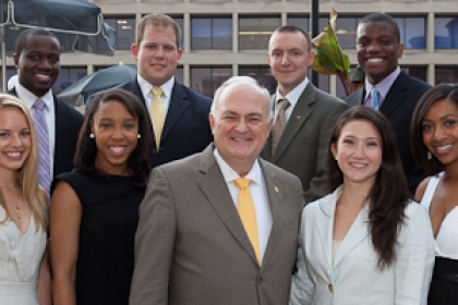 Presidential Administrative Fellows stand with Steven Knapp