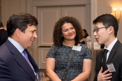 elson Carbonell, Jr., chats with School of Engineering and Applied Sciences students Olivia Hoerle and Jay Lee. (Erin Scott)