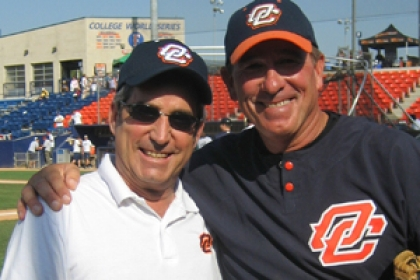 Robert Young and coach in baseball uniform smiling arm-in-arm on field