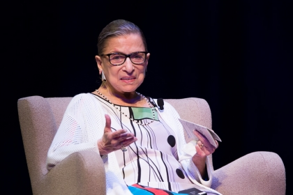 Ruth Bader Ginsburg speaks sitting on chair
