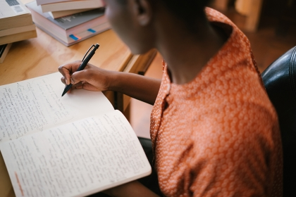 Stock image of woman taking notes
