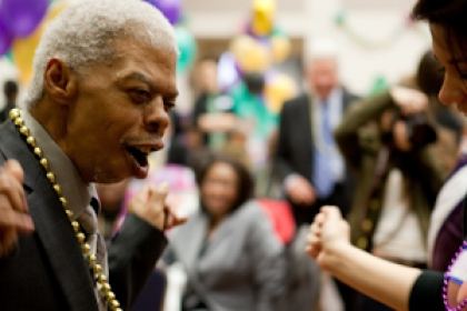 students and senior citizens dance at the senior prom