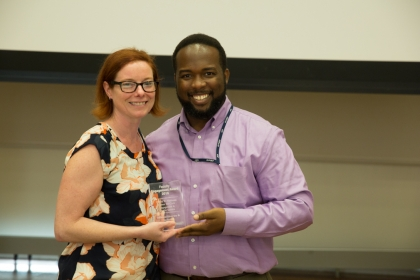Maurice Smith, coordinator of academic service learning, with Engaged Faculty Award winner Tara Scully. (William Atkins/GW Today