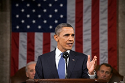 President Obama delivers the State of the Union address in U.S. Capitol with speaker and vice president seated behind him