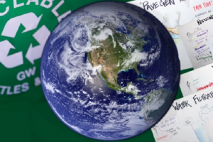 globe, recycle symbol and papers