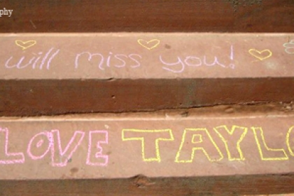 "stairs where students have written messages and drawn pictures in chalk including ""We will miss you"" and ""We love Taylor"""