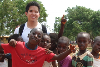 Andrew Pangilinan in Ghana with children during community service mission for Unite for Sight