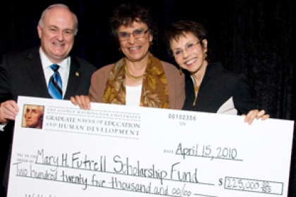 Steven Knapp and Mary Futrell with oversized check for her scholarship fund