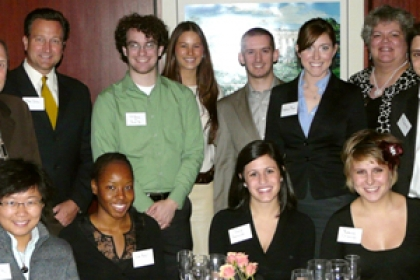 students at event at Mortons standing as a group