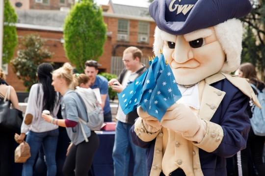 George the mascot with commander-in-chief flags