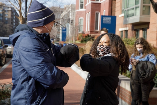 President LeBlanc bumps elbows with a student during spring move-in